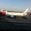 Norwegian 737-800 Parked at Stockholm Arlanda with Austrian Fokker 100 in the Backround